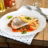 Steamed sea bream fillet on a bed of ratatouille