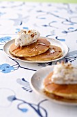 Pancakes garnished with white chocolate mousse,pecans and maple syrup