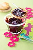 Toasted muffin with blueberry and raspberry jam