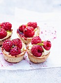 Raspberry,vanilla-flavored mascarpone,pistachio and redcurrant syrup tartlets