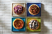 4 different tartlets :onion,duck,vegetable and anchovy