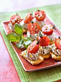 Herby cream cheese and cherry tomato Tuc cracker appetizers
