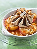 Roasted peaches with caramelized almonds and vanilla ice cream