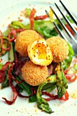 Breaded soft-boiled eggs with asparagus-bacon salad