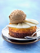 Small pear and speculos ginger biscuit cheesecake topped with a scoop of toffee ice cream
