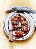 Grilled tomatoes with fresh herbs