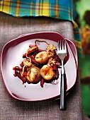 Tintenfische mit Chorizo, Tomaten und Paprika