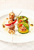 Beff,mushroom and chili pepper brochette,sliced cougette,tomato,anchovy and basil