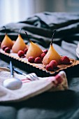 Poached pear,almond cream and raspberry gluten-free tart