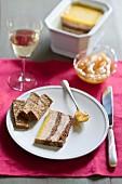 Foie gras and fig terrine,stewed pear sauce