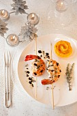 Gambas and chicken marinated with truffles,sweet potato puree