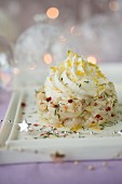 Scallop tartare with pink peppercorns and dill,lemon whipped cream