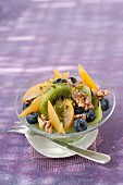 Kiwi,plum,blueberry,walnut,pistachio and honey fruit salad