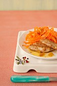 Curried veal escalope,carrot and raisin salad