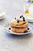 Pancakes with cream cheese, honey and blueberries