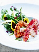Marinated and roasted shrimps,sprout and pansy salad,lemon-flavored cream