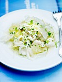 Hake with lemon pulp and fresh herbs