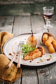 Chicken breast with Port sauce,poached pear and potato croquettes