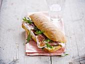 Italian smoked ham and rocket lettuce ciabatta bread sandwhich