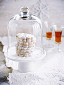Amarettis shortbreads under a glass dome