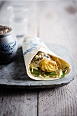 Curried pollock,white cabbage and caper sauce wrap