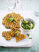 Spicy potato wafles with mixed lettuce salad