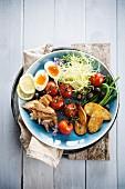Salad niçoise style dish with mackerel