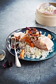 Poached salmon with carrots and rice with coconut milk