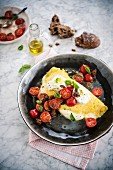 OOmelet with mozzarella and cherry tomato salad
