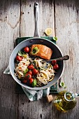 Salmon and spaghetti with lemon, tomatoes and basil
