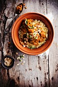 Pork,apricot and almond tajine with semolina