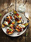 Aubergines stuffed with semolina,cream and green and purple basil