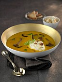 Cream of pumpkin soup with pleurotus mushrooms and hazelnut cream