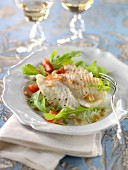 Oven-baked turbot fillet with hazelnut oil and pine nuts