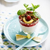 Funny face fromage blanc with mint, raspberry coulis and muesli