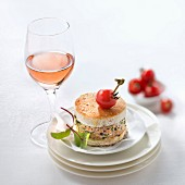 A mini veal burger with coriander and a glass of rosé wine