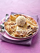 Pancake with vanilla ice cream and almonds