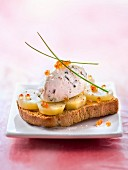 Gourmet tartine with steamed potatoes and salmon egg cream with chives