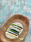 Raw sardines with green and white asparagus on horseradish sauce