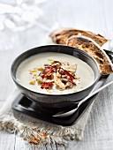 Cream of cauliflower soup with chorizo, foie gras and hazelnuts
