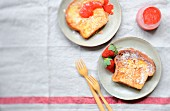 Brioche french toast with thinly sliced almonds and strawberry coulis