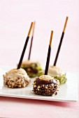 Mikado cake pops with a twist, with ice cream, chocolate and dried fruits