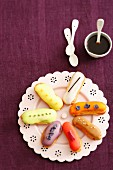 Various eclairs on a plate