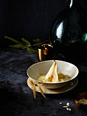 Poached pears with Champagne sabayon and almonds