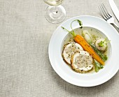 Pork roast stuffed with vegetables,spring vegetable broth