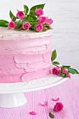 Yoghurt cream cake with raspberry jam and roses