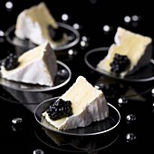 Four portions of Camembert with caviar
