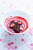 Moist chocolate cake and strawberry coulis with Sechuan pepper