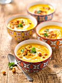 Spicy cream of carrot, ginger sweet corn and chickpea soup