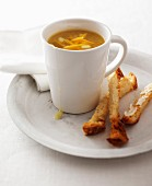 Pumpkin soup with buttered soldiers